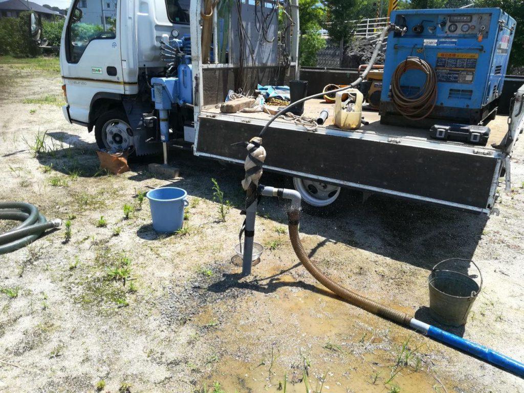 地質調査ボーリングパイプの洗浄